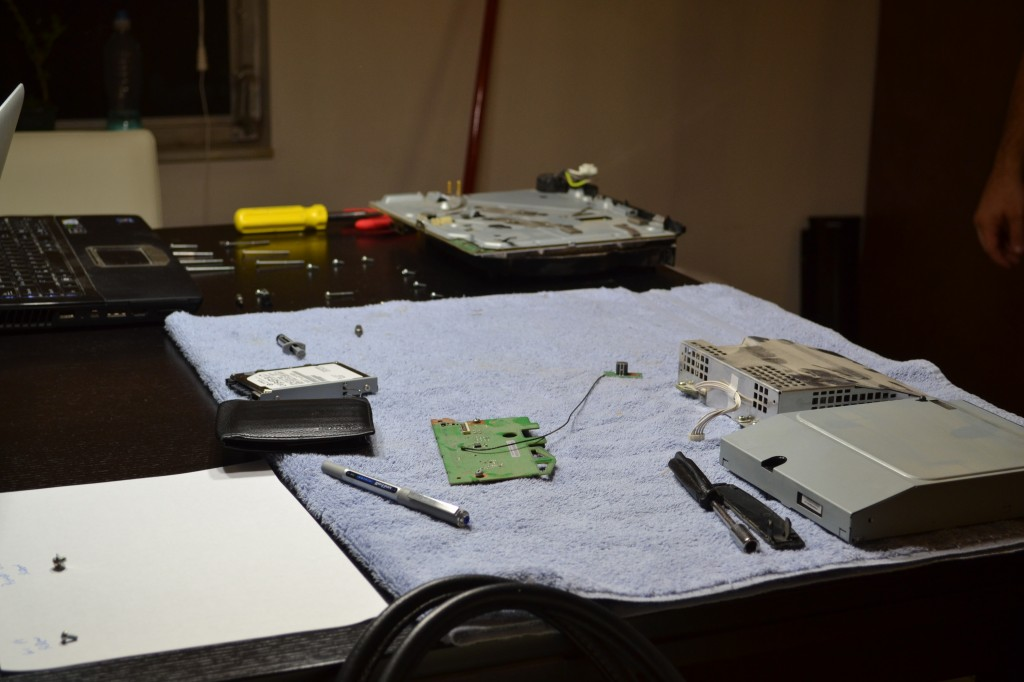 In surgery: guts on the table.  Power supply, blue-ray player, small circuit board.